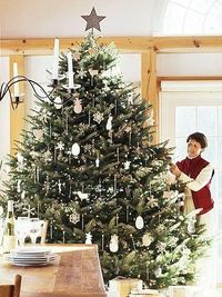 Perfectly Placed: For a classic look, take the time to decorate the tree piece by piece, considering spacing and symmetry as you hang the ornaments. Delicate glass icicles give this tree a pretty uniformity.