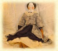 Doll from the War era in period clothing ~ Antique Child.
