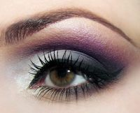 Purple and gray eye makeup with black liner.