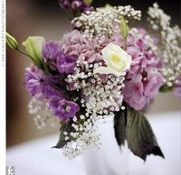 Purple centerpieces; roses, baby's breath, and stock
