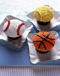 """Root for your favorite team with our easy-to-decorate cupcakes. Colorful sprinkles are used to simulate the bumpy texture of baseballs or softballs, on top of which the """"seams"""" are piped with buttercream."""