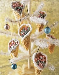 "shape warm pizzelles into cone. Carefully poke a hole in each side (for hanging ribbon). Frost edge and dip in decorative sugars. Fill with small candies (m""s?)"
