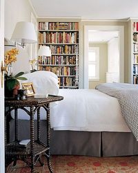 In the master bedroom, an upholstered headboard is ideal for reading in bed. Wall lamps provide proper lighting while freeing up space on the end tables.