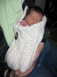 "Button-up Baby Wrap, a ""cocoon"" for newborns. Too cute for words! I need to find someone who knows how to knit!"