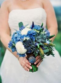 Can pick one of these blues to match the dresses a bouquet of blue aggies, blue hydrangea, blue thistle, white dahlias, green seeded euc, blue viburnum berry, blue veronica, and green millet.
