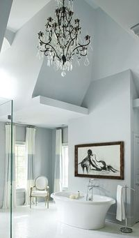 Asymmetrical bathroom in a cool blue