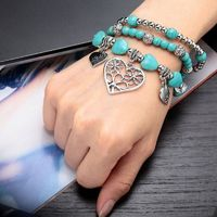 This 3 piece Charm Bracelet Set features turquoise, silver and crystal beaded stretch bracelets dangling silver heart charms. The Crystal Turquoise Silver Bead Heart Charm Bracelet Set is handcrafted of antique silver plating and genuine turquoise stones.