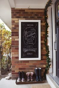 A chalkboard welcome sign for the front door, so love this!