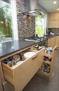 Deep storage drawers in kitchen cabinets.