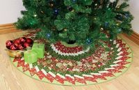 Holly & Ivy Tree Skirt by Diane Nagle is one of the featured patterns on Day 8 of the 12 Days of Best Christmas Quilts Blog Tour. Click through to the Quilters Newsletter blog on 8/29 to learn more, including how you can enter to win a fat quarter bun...