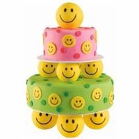 """Happy days are here again! Draw smiley faces on fondant circles using a black FoodWriter�""""� Edible Color Marker. Place the faces on vibrantly dressed cakes and globes from our Globe Pillars and Base Sets."""