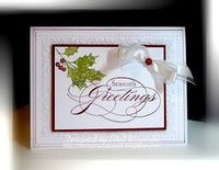 Stamps: Peacefiul Season Paper: Whisper White, Cherry Cobbler Ink: Old Olive, Cherry Cobbler Accessories: satin ribbon, glitter brad Tools: Big Shot, Petals a Plenty EF, piercing tool