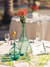 Patterned fabric + vases with single flowers