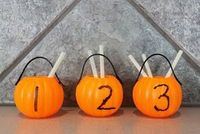 Counting Straws with pumpkins.