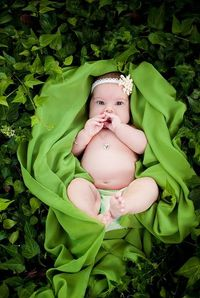 A patch of green ivy, flowy green fabric, and a 3 month old baby. Snap and repeat ; )