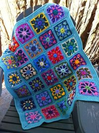 Kaleidoscope Granny Square baby afghan.