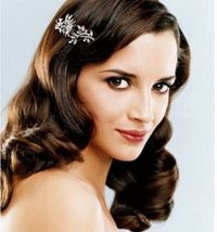 wavy down bride hairstyle with crystal hair clip