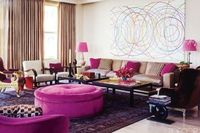 Jamie Drake proves that focusing on a single jewel tone has high impact. Love the round poof