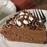 Chocolate Lovers Chocolate Mousse Pie - This amazing Chocolate Lover's Chocolate Mousse Pie has a chocolate crust with a milk chocolate coating, fluffy chocolate filling, whipped cream and is topped with a chocolate drizzle. Perfect for entertaining...