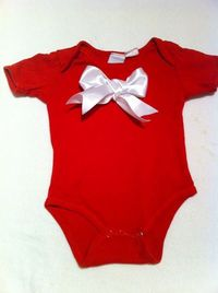Stitch a satin ribbon bow onto the front of a plain onesie