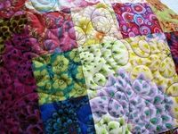 swirly or loup-de-loup quilting