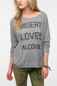 While I don't think these should be marketed toward kids (under 21), I would totally wear this. Corner Shop Misery Loves Alcohol Long-Sleeved Tee #UrbanOutfitters