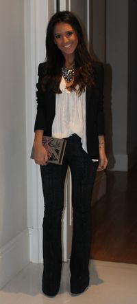 jacket flowy blouse tight black pants and black pumps and statement nechlace