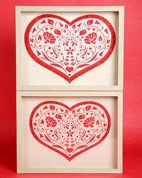 Martha and in-house art director Anduin Havens demonstrate how to make beautiful paper-cut hearts for Valentine's Day.