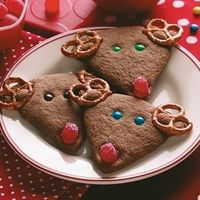 Chocolate Reindeer Cookies Recipe from Taste of Home -- You can enlist little hands to help position the antlers, eyes and noses on these adorable, crisp reindeer cookies.