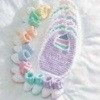 Crochet a bib and booties set for each day of the week with Monday-Sunday embroidered on the bibs. This clever and adorable idea for what to crochet baby makes for a great shower gift.