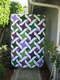 This is a Ninja star quilt I made for my friend's wedding.http://quillsandquilts.blogspot.com/2011/08/ninja-stars-at-wedding.html