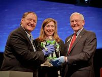 "John Lasseter, Director of the film ""Toy Story"", left, NASA Deputy Administrator Lori Garver, and Gen. J.R. ""Jack"" Dailey, right, hold Buzz Lightyear of the film at the Smithsonian National Air and Space Museum's Moving Beyond Earth Ga..."