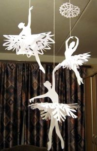DIY Ballerinas' Snowflakes. Snowflakes and cut out silhouettes of ballet dancers. Really clever. Instructions from the Russian Blogdeviatsia here.