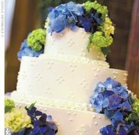 three-tiered cake adorned with blue, green, and lavender hydrangeas. It featured a chocolate-raspberry flavor in the middle tier and a lemon-raspberry flavor in the others.