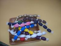 Make this wooden beads painted thick cording